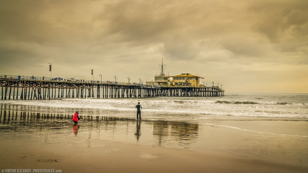 The photo of Santa Monica pier shot on cloudy winter day