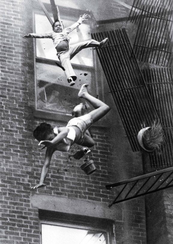9. Woman Falling From Fire Escape, Stanley Forman (1975)